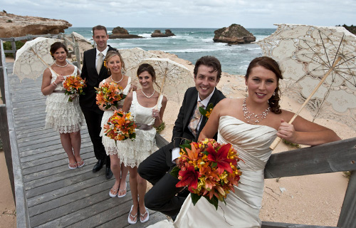 Wedding Photography of a bridal party on a walkway at a Melbourne Ocean beach in wild, windy weather