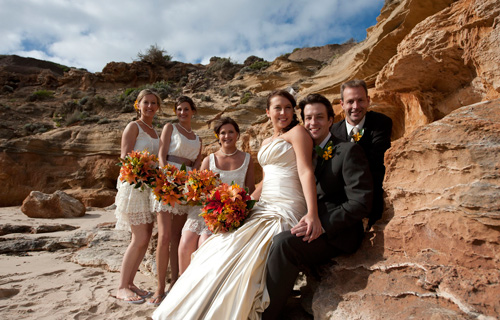 Wedding Photography of a Melbourne bridal party among the rocks on an ocean beach foreshore.