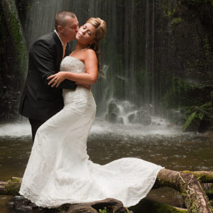 Wedding Photography Melbourne a photo of newlyweds by a cascading waterfall in outer Melbourne.