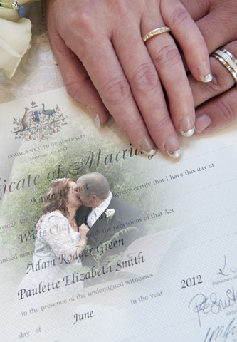 A wedding certificate photo with bridal bouquet and rings at Whitechapel