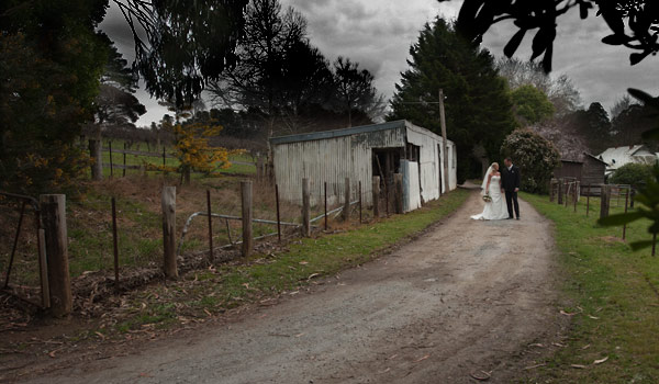 A wedding photo showing a melbourne bridal couple walking along a quiet country lane