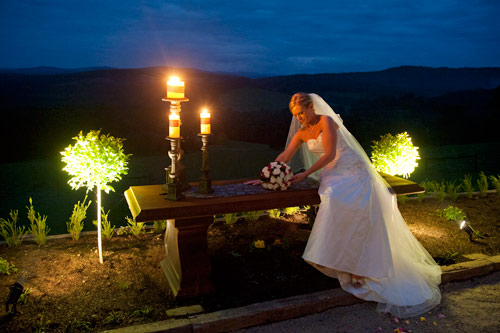 night shot wedding photography melbourne- a bride is photographed with candle light illumination