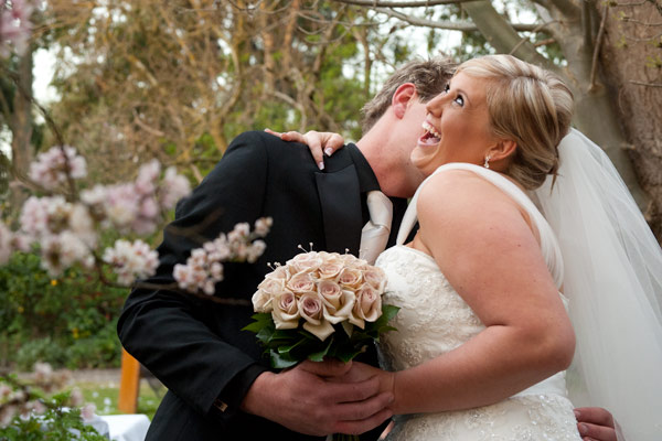 A just-married couple enjoys some candid fun at Warrook Farm, Victoria