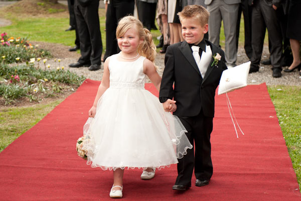 The ring-bearer page boy and flowergirl walk down the aisle at Warrook farm Victoria