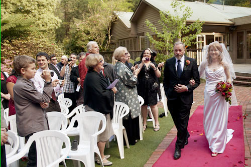 A photo of a bride arriving with her father, for her Lyrebird Falls wedding.