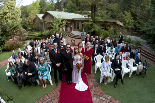 A group wedding photo taken at Lyrebird Falls, Melbourne