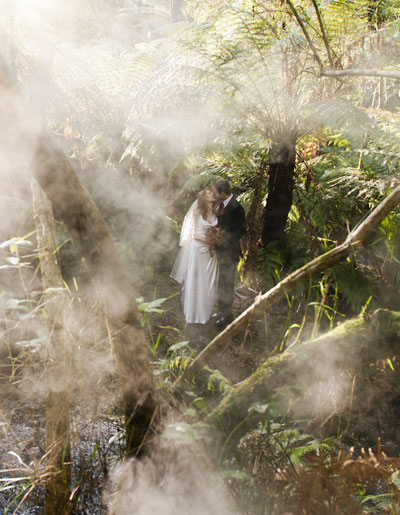 Mist lends a surreal quality to this wedding photo taken in the forest at Lyrebird Falls