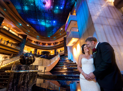 A wedding photo of newlyweds in the foyer of Crown Casino, Melbourne