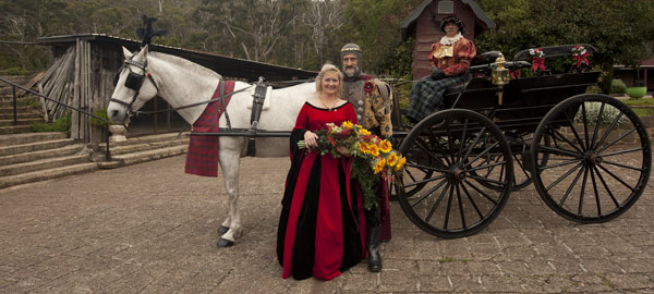 A wedding photo showing a medieval bridal couple with a horse drawn carriage at Kryal Castle, Ballarat.