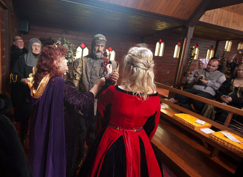 Exchanging vows during a medieval wedding at Kryal Castle Ballarat.