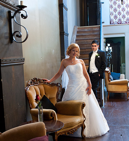 A bride and groom by the staircase in a Melbourne bar