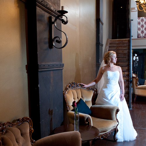 Wedding Photography of a bride on her wedding day, with an old staircase s a backdrop