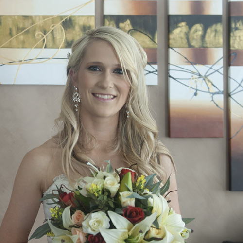 Wedding Photography with bride posed in front stylish art.
