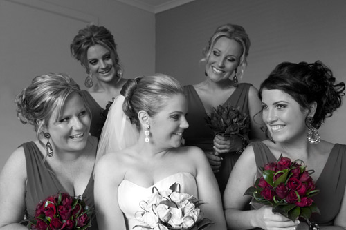 Wedding photography in part black and white, part color, showing bride and attendants.