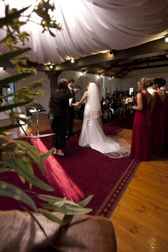 The bride walks down the aisle to her wedding ceremony at Potters Reception Melbourne
