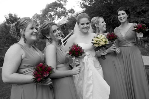 A bride with her bridesmaids outside the chapel at Potters