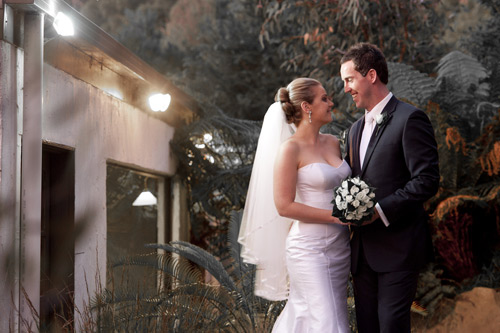 The bride and groom in a close-up shot behind the reception room at Potters Warrandyte.