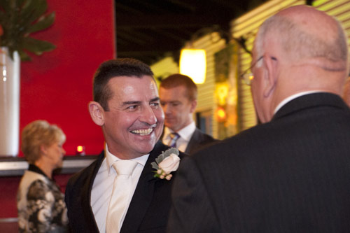 Groom shares fun moment with a guest at All Smiles Wedding venue