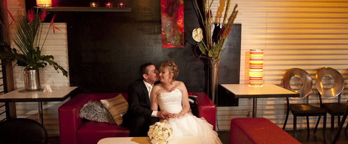 Bride and groom on the lounge at All Smiles Warrandyte