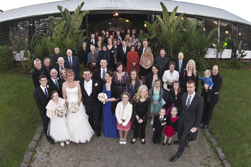 Full group photo of All Smiles wedding party and guests