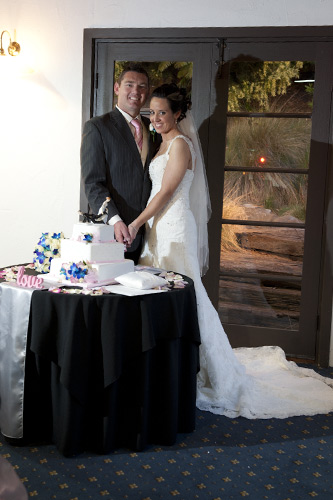 bridal couple cut their wedding cake, potters reception