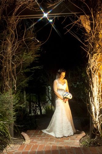 night wedding photo of bride in arch, potter reception