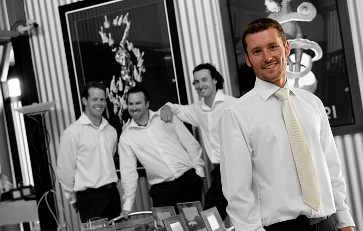 groom and groomsmen at pier 10 wedding reception room