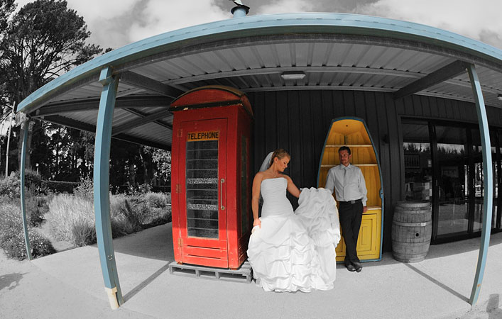wedding couple in old style red phone box