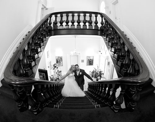 Wedding couple on stairs at Treacy Centre
