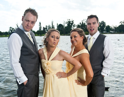Wedding photo of bridal party having fun