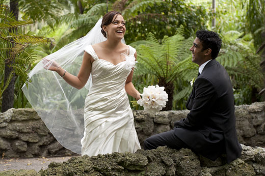 beautiful bride laughs to her groom