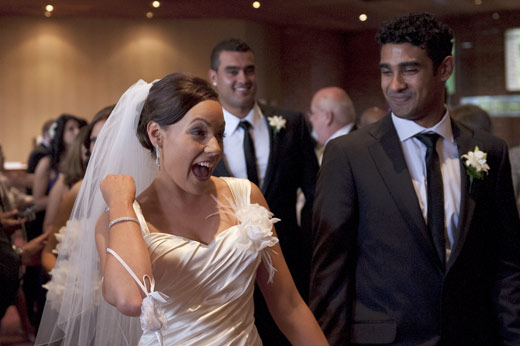 bridal couple leave the church after getting married
