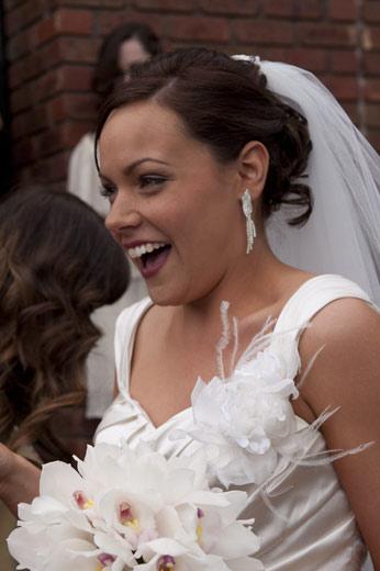 candid, unposed wedding photo of bride